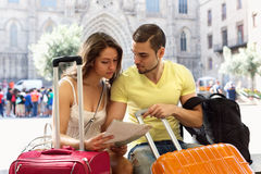 Couple with map on city streets Stock Photos