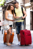 Couple with map on city streets Royalty Free Stock Photo