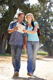 Couple with map on country walk Stock Photo