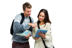 Couple with map and digital tablet while traveling Royalty Free Stock Photo