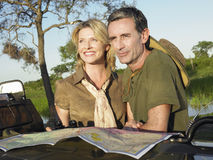 Couple With Map Looking At View Royalty Free Stock Photos
