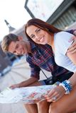 Couple with map outdoors Royalty Free Stock Photos