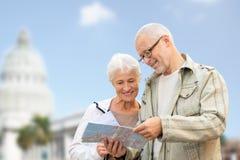 Couple with map over washington white house Stock Photos