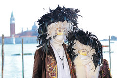 Couple of masks with feathers at the Carnival of Venice Royalty Free Stock Image