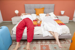 Couple of mature people relaxing in the bedroom Royalty Free Stock Images