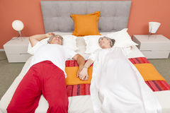 Couple of mature people relaxing in the bedroom Royalty Free Stock Image