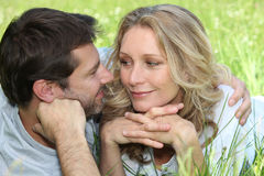 Couple in a meadow Royalty Free Stock Photo