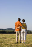 Couple in a meadow Stock Images