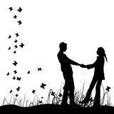 Couple on meadow, black silhouette Stock Photos