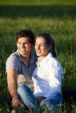 Couple on meadow in sunset Royalty Free Stock Images
