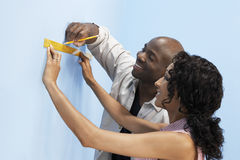 Couple Measuring Interior Wall Royalty Free Stock Photos