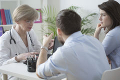 Couple and medical consultation Royalty Free Stock Photo
