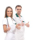 A couple of medical workers holding thumbs up Royalty Free Stock Photography