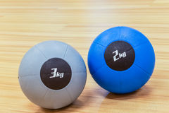 Couple of medicine weight ball on wooden floor Stock Image