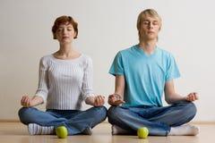 Couple meditating Stock Photos