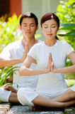 Couple Meditating royalty free stock photos