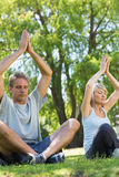 Couple meditating in the park Stock Image