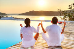 Couple meditating together at sunrise. In Greece Stock Image