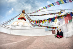 Couple meditation near Bodnath stupa Royalty Free Stock Photos