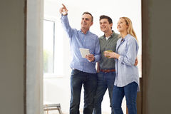 Couple Meeting With Architect Or Builder In Rennovated Property. Couple Meet With Architect Or Builder In Rennovated Property Royalty Free Stock Photos