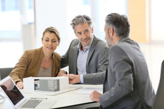 Couple meeting architect for construction project Royalty Free Stock Photography