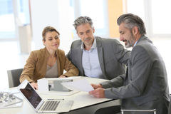 Couple meeting architect discussing construction Royalty Free Stock Images