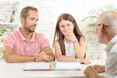 Couple meeting architect for future house Stock Photo