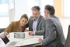 Couple meeting with an architect Stock Photos