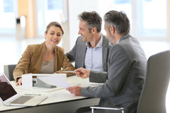 Couple meeting architect to discuss new construction Stock Photos