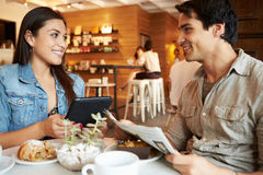 Couple Meeting In Busy Cafe Restaurant Stock Photos