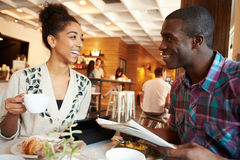 Couple Meeting In Busy Cafe Restaurant Stock Photography