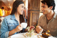 Couple Meeting In Busy Cafe Restaurant Royalty Free Stock Photo