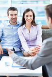 Couple meeting with consultant. Young couple meeting with consultant Stock Photos
