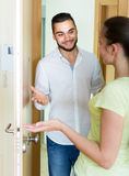 Couple meeting each other at the doorway Stock Photo