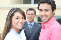 Couple meeting estate agent. Young couple meeting with an estate agent Stock Photography