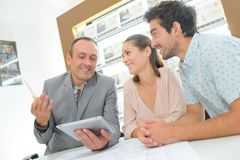 Couple in meeting with estate agent stock image