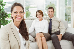 Couple in meeting with a female financial adviser Stock Image
