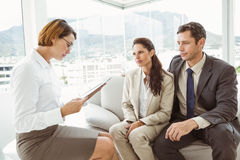 Couple in meeting with a financial adviser Stock Photos