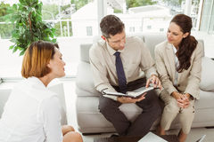 Couple in meeting with financial adviser at home Royalty Free Stock Photography