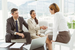 Couple in meeting with financial adviser at home Stock Images