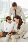 Couple in meeting with financial adviser at home Royalty Free Stock Image