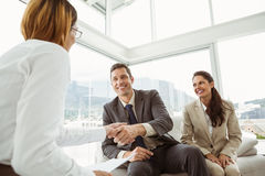 Couple in meeting with financial adviser at home Royalty Free Stock Photos
