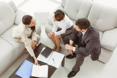 Couple in meeting with financial adviser at home Stock Image