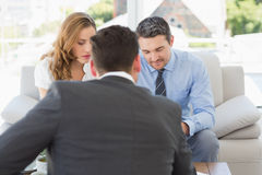 Couple in meeting with a financial adviser at home Stock Photo