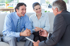 Couple in meeting with a financial adviser Royalty Free Stock Photo