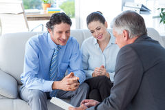 Couple in meeting with a financial adviser Stock Image