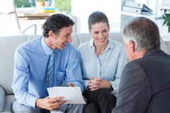 Couple in meeting with a financial adviser Royalty Free Stock Photos