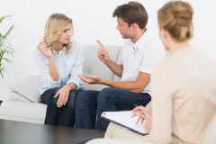 Couple in meeting with a financial adviser Stock Images