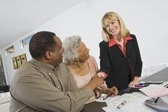 Couple Meeting Financial Advisor Stock Photo