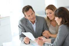 Couple meeting financial advisor Royalty Free Stock Photography
